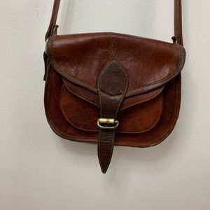 Vintage rich brown leather saddle bag